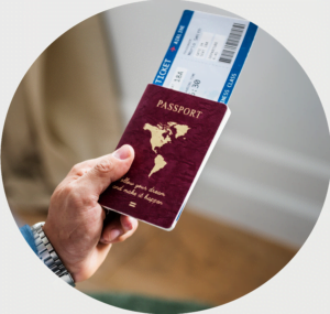 hand holding a passport with ticket